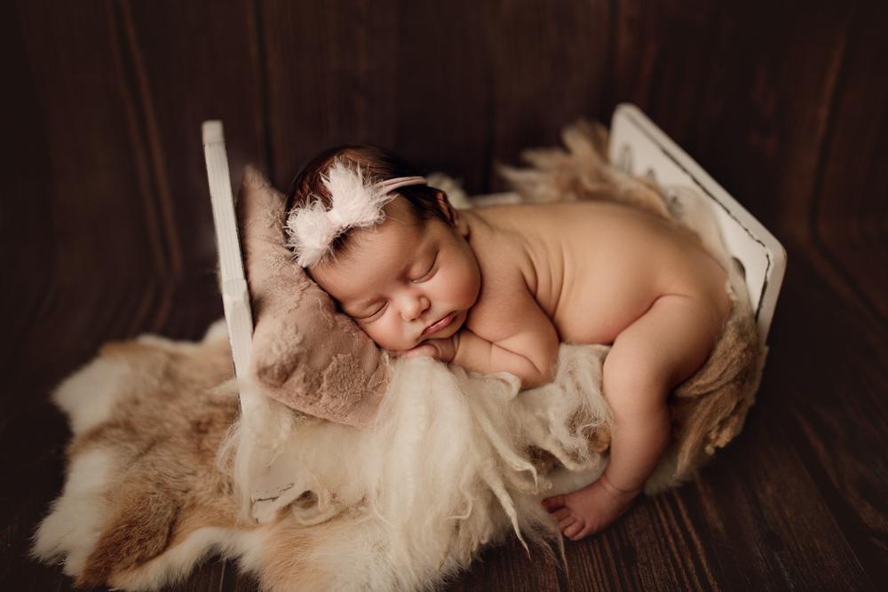 Проведение фотосессии для новорожденных